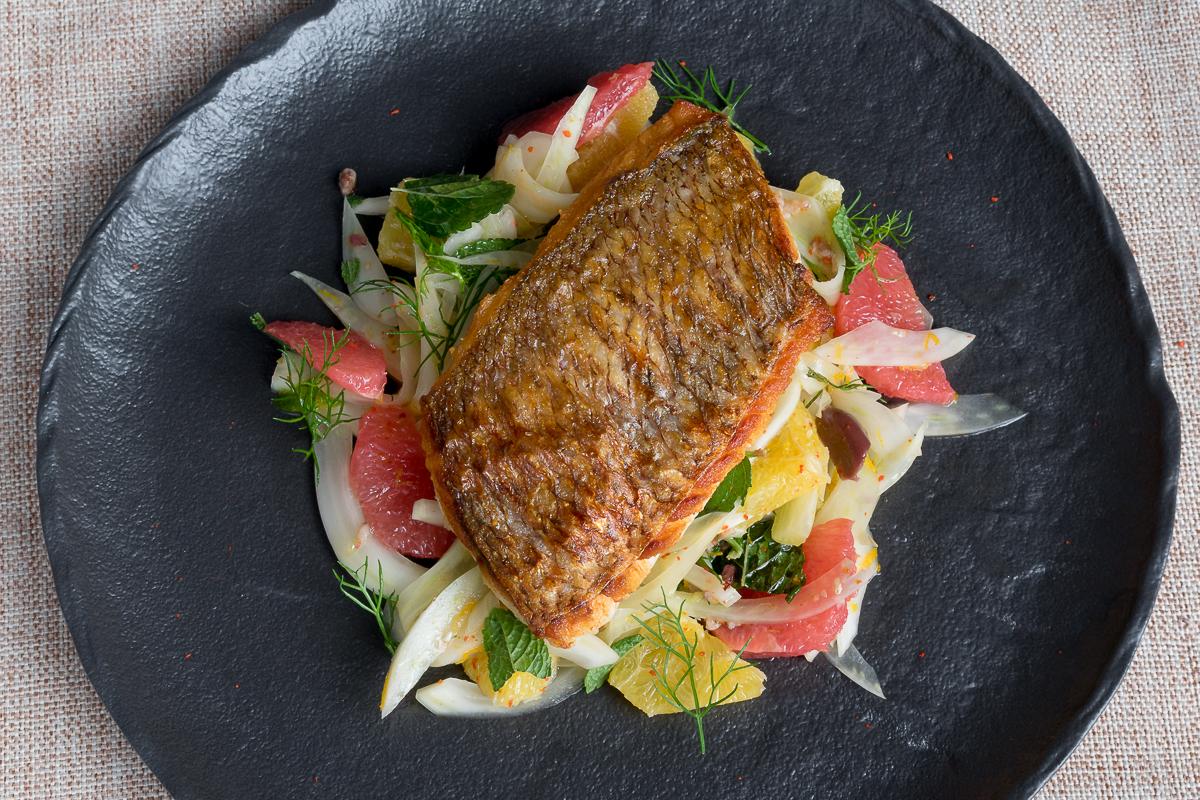 Crispy skinned fish on fennel and citrus salad