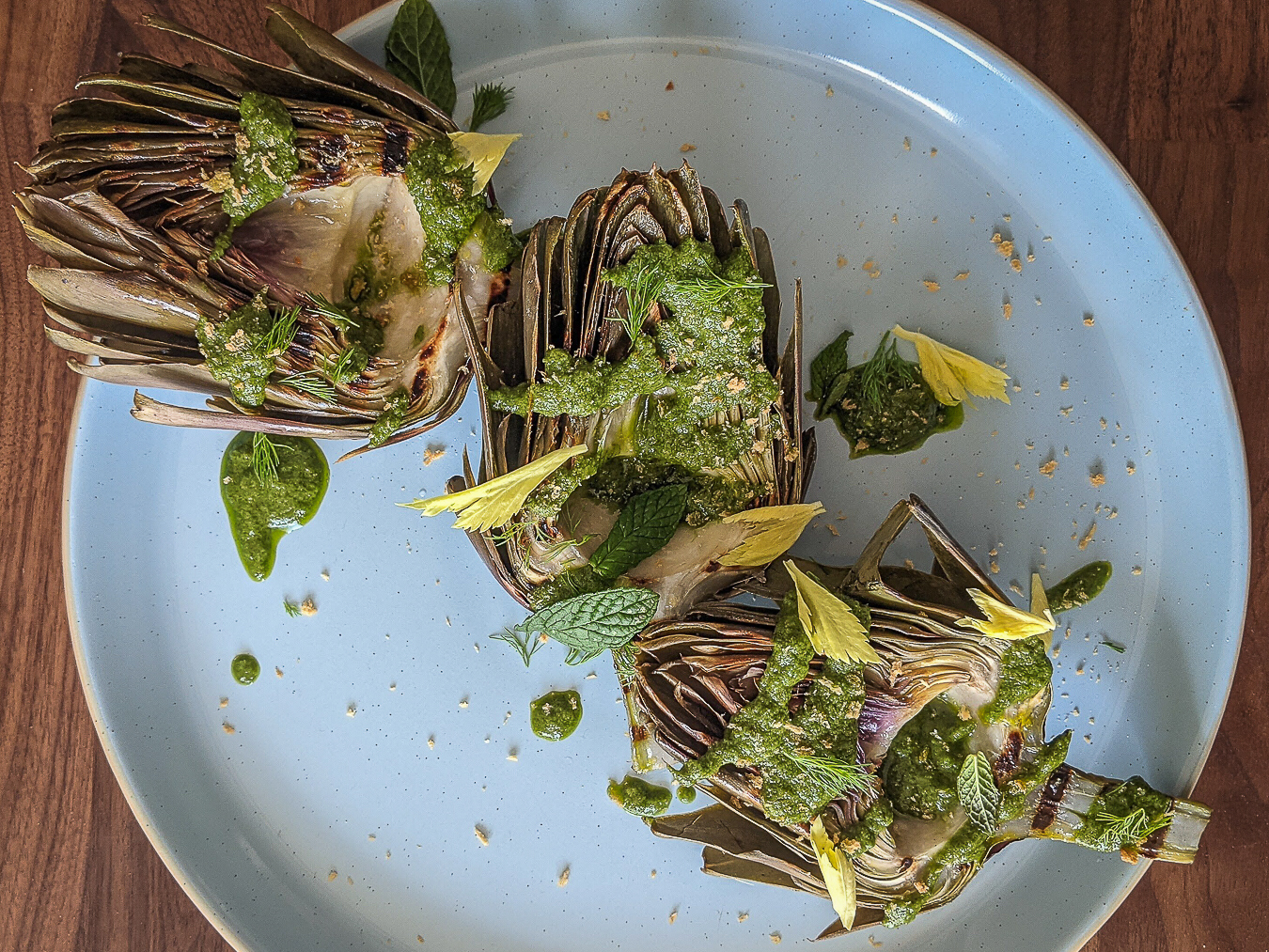 Grilled artichokes with salsa verde and herbs