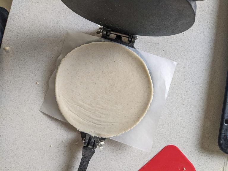 Corn tortilla in taco press